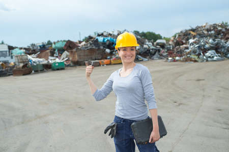 portrait of woman in scrapyard