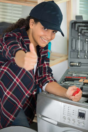 female plumber showing thumb-up