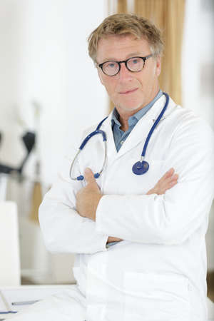 a mature handsome doctor man Stock Photo