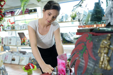woman checking product of funeral sho