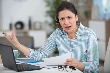 frustrated young businesswoman wearing headset