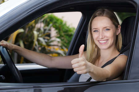 female driver showing ok sign