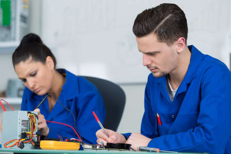 students in electronics class at university