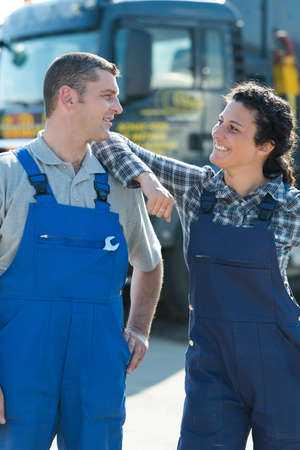 professional auto woman and man mechanic outdoors