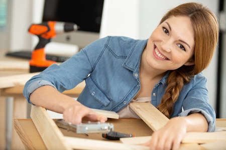 happy woman during self assembly furniture