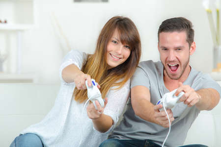 a couple playing video games Stock Photo