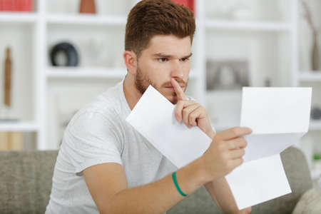 young man reading his mail