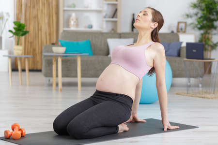 a pregnant woman during fitness