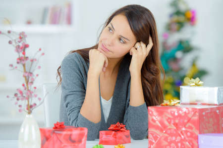 Woman sat with wrapped gifts
