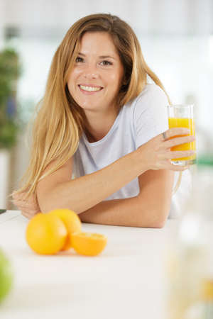 beautiful young woman with glass of orange juice