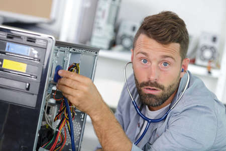 repairman working in technical support fixing computer laptop