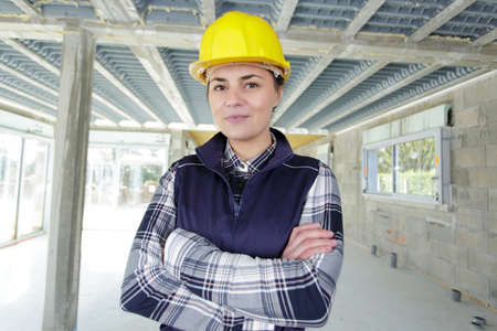 woman engineer wearing safety helmet with cross arm