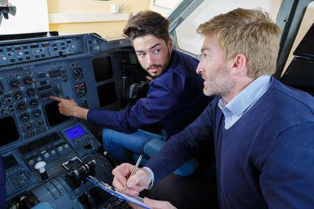 engineers in the pilot cockpit Stockfoto