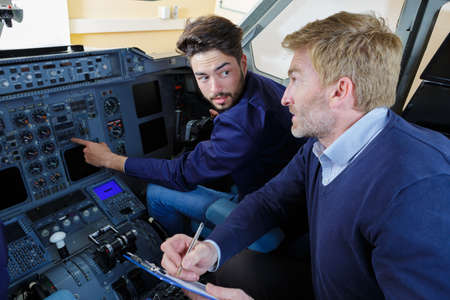 engineers in the pilot cockpit Imagens