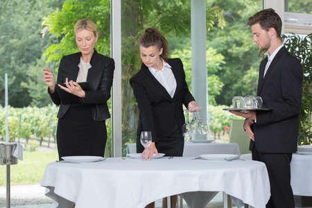 the waiters preparing wedding reception