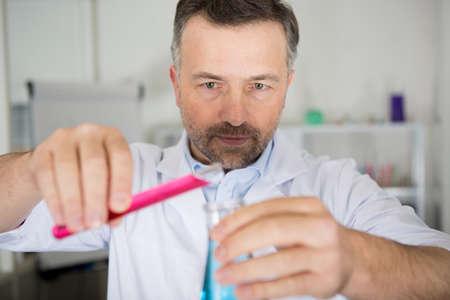 sscientist mixes to liquids in lab