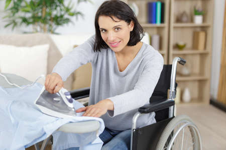 disabled woman doing the ironing
