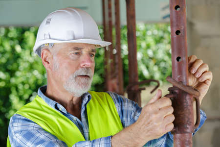 mature manual worker at factory