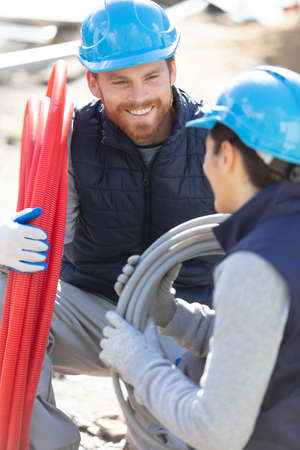 builders working at a building under construction Stock Photo
