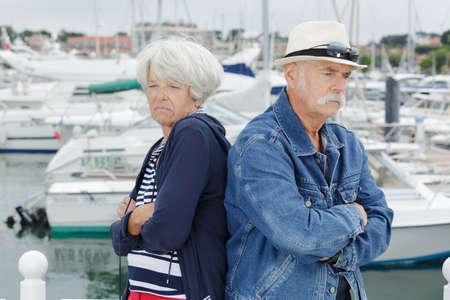 upset senior couple on holidays