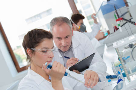 focused attractive young life science researcher during test