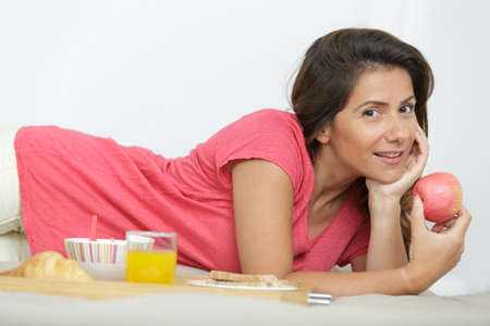a woman breakfast in bed Stock Photo
