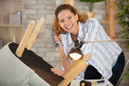 young woman renewing chair smiling