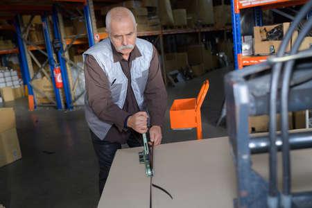 senior worker in warehouse