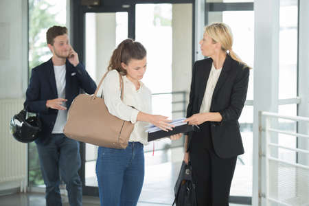 Businesswoman meeting young people in the lobby