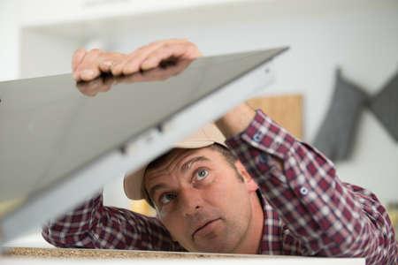 plumber installs a kitchen sink