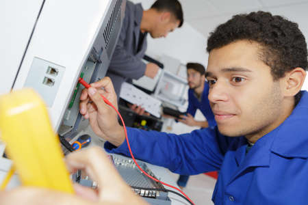 trainee electricians learning their trade