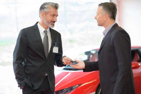 car dealer showing auto garage