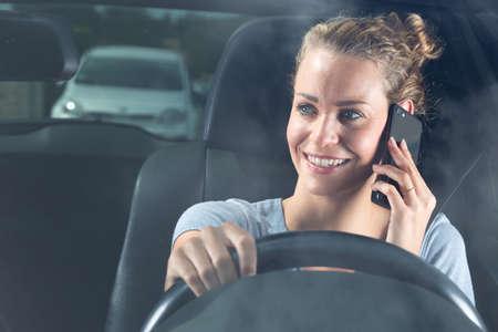 woman traveler using smart phone car inside Standard-Bild