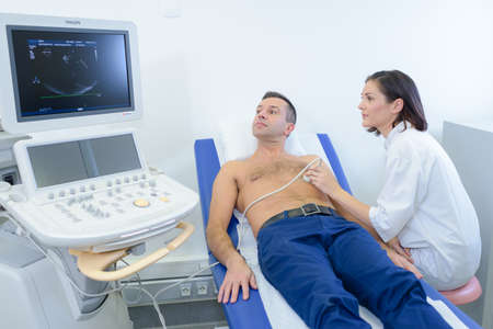 Male patient having heart scan