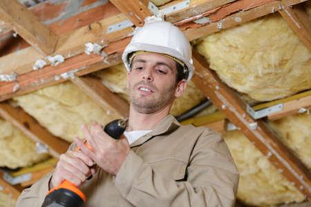 a carpenter using a drill Фото со стока