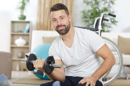 muscular disabled man using weights