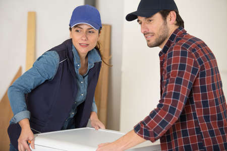 man and woman delivering washing machine
