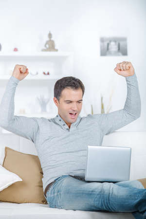 a man is celebrating success