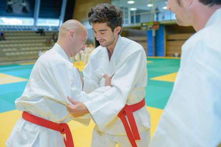 portrait of men practicing judo