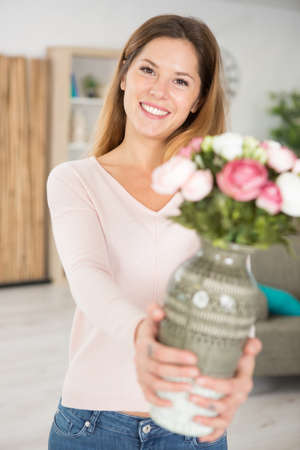 portrait of attractive mature woman with a vase Stockfoto