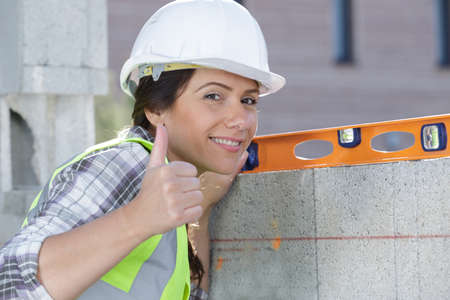 female construction worker with thumbs up