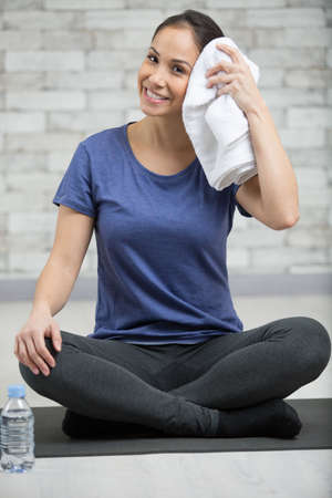 woman towelling off after exercising Reklamní fotografie