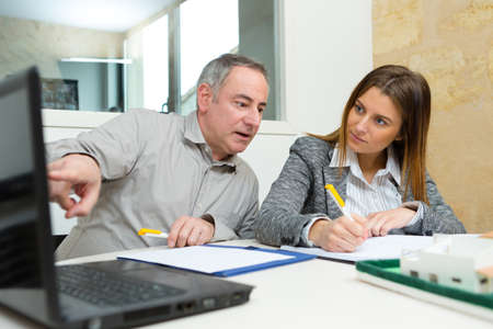 female and male architect talking in his office