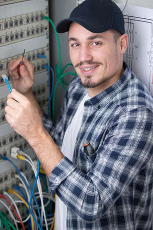 man is repairing the switchboard voltage