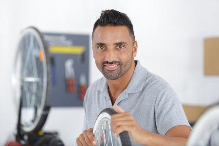 man sellertalking to customer while fixing bike