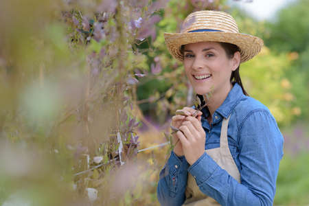 a woman gardening outdoors smiling 免版税图像
