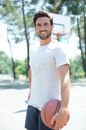 handsome male playing basketball outdoor