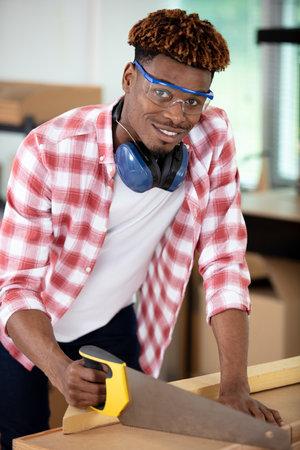 young black carpenter at work smiling