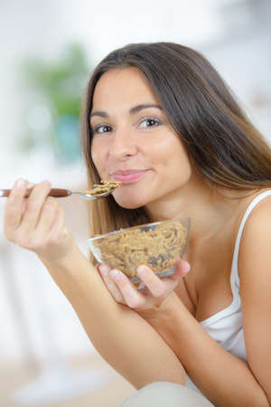 Lady enjoying a bowl of bran flakes