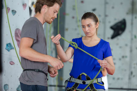 strong man and woman preparing cord for climbing up Zdjęcie Seryjne
